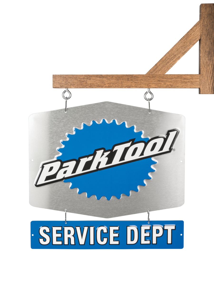 The Park Tool SDS-1, Service Department Sign — Single-Sided on a wooden post, enlarged