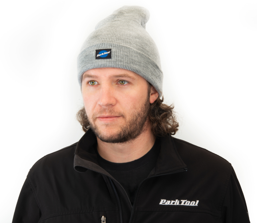 Park Tool STK-1 heather gray beanie being work by Tech Guy Truman with hem folded up, enlarged