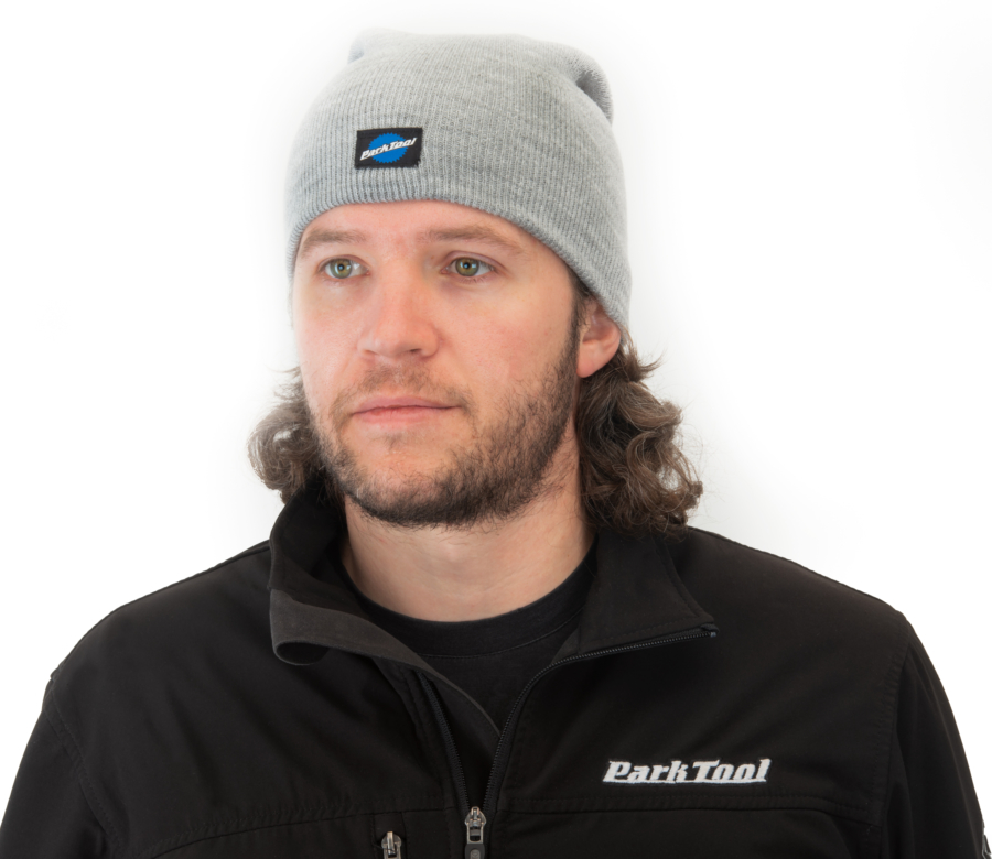 Park Tool STK-1 heather gray beanie being work by Tech Guy Truman with hem folded down, enlarged