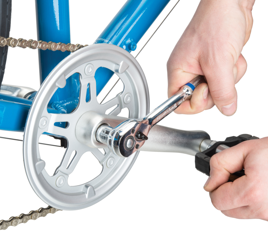 """The Park Tool SWR-8 3/8"""" Drive Ratchet Handle working on a bike pedal, enlarged"""