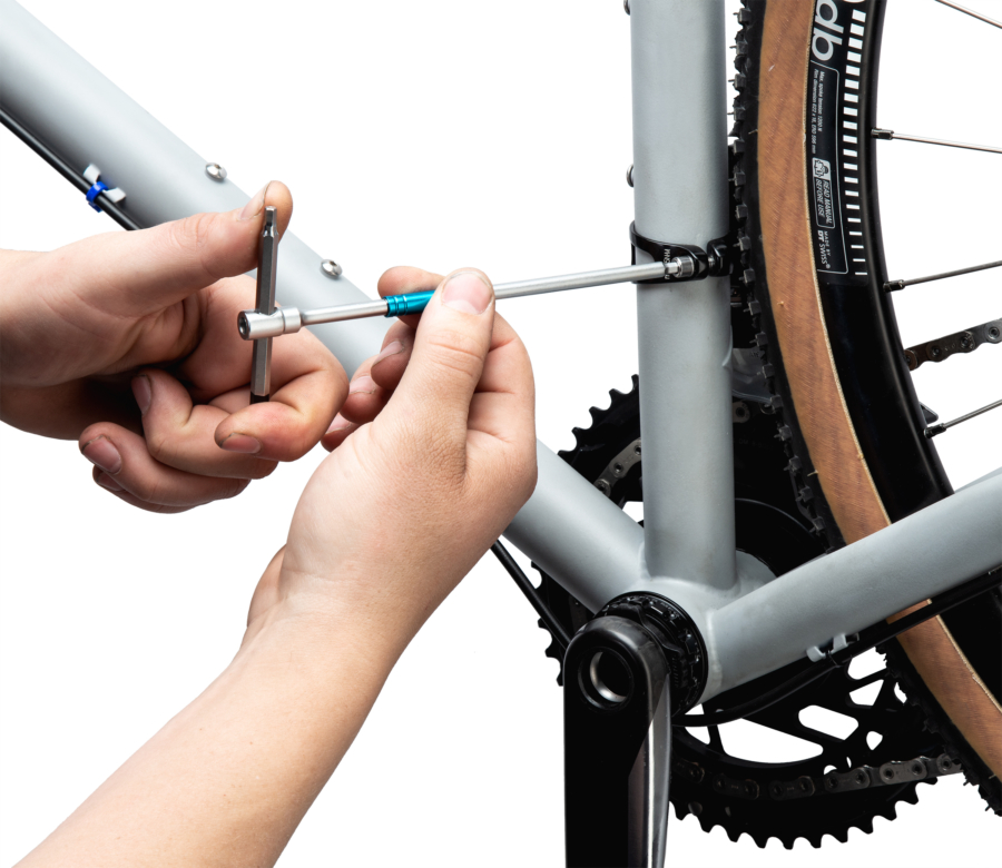 THH-4 4 mm hex wrench tightening a front derailleur mounting bolt, enlarged