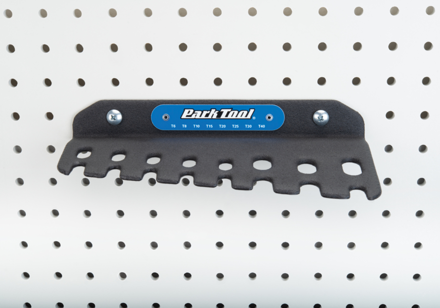 Park Tool THT-1 Sliding T-Handle Torx Compatible Wrench holder hanging on a pegboard, enlarged