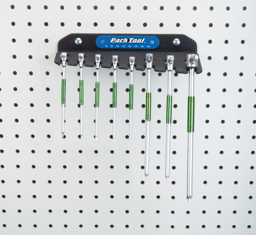 Park Tool THT-1 Sliding T-Handle Torx Compatible Wrench Set hanging on a pegboard, enlarged