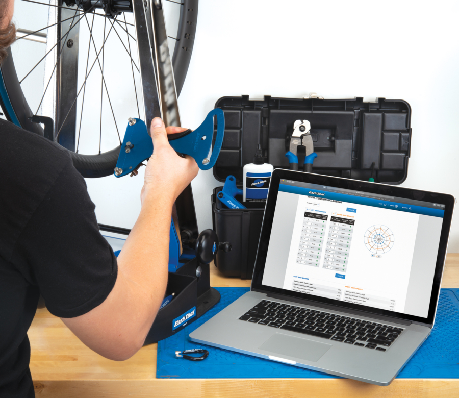 The Park Tool TM-1 Spoke Tension Meter being used with the Park Tool Wheel Tension App, enlarged