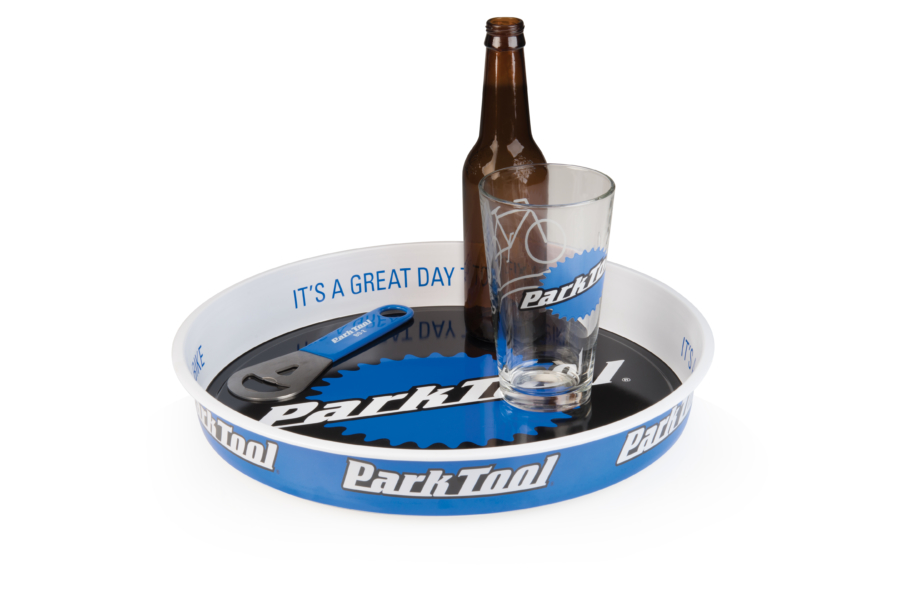 The Park Tool TRY-1 Parts and Beverage Tray holding beer bottle and pint glass, enlarged