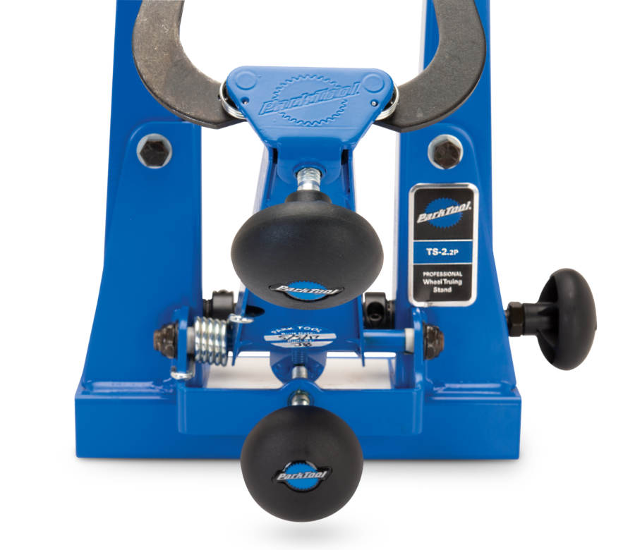 Front of TS-2.2P Powder Coated Professional Wheel Truing Stand with caliper and caliper arm adjustment knobs, enlarged