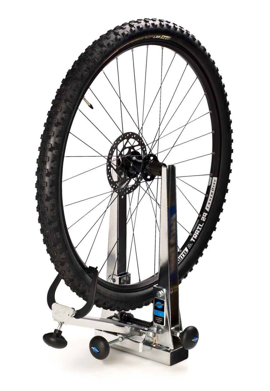 Bike wheel in The Park Tool TS-2.2 Professional Wheel Truing Stand, enlarged