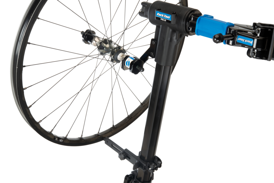 Park Tool TS-TA Thru Axle Adaptor holding a bike wheel in a TS-25 Repair Stand Mounted Wheel Truing Stand, enlarged