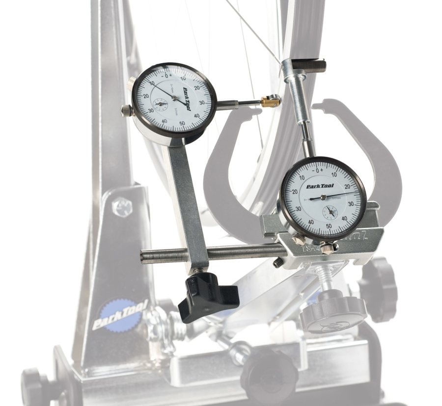 The Park Tool TS-2Di Dial Indicator Gauge Set on truing stand, enlarged