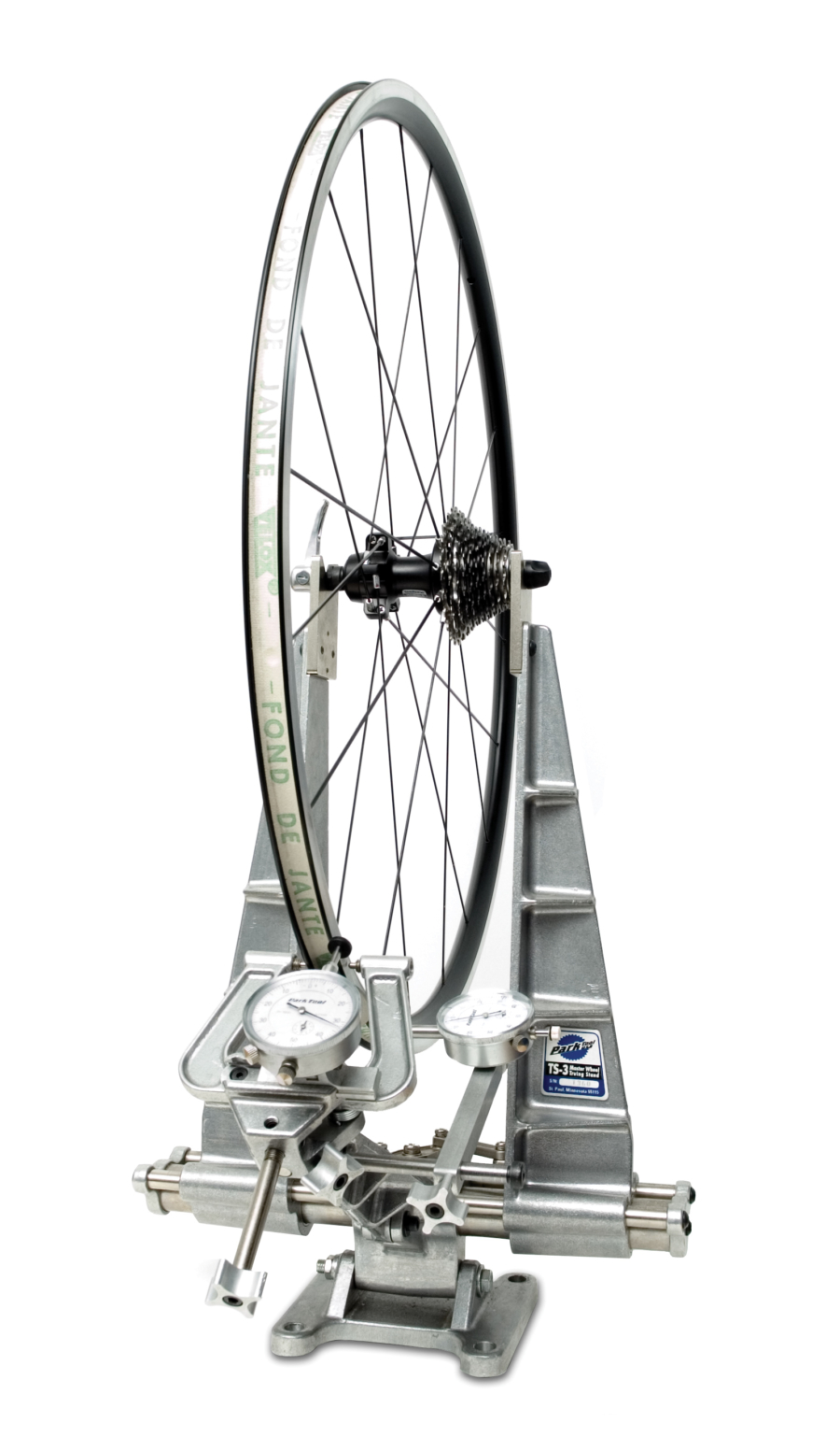 The Park Tool TS-3 Master Truing Stand holding wheel, enlarged