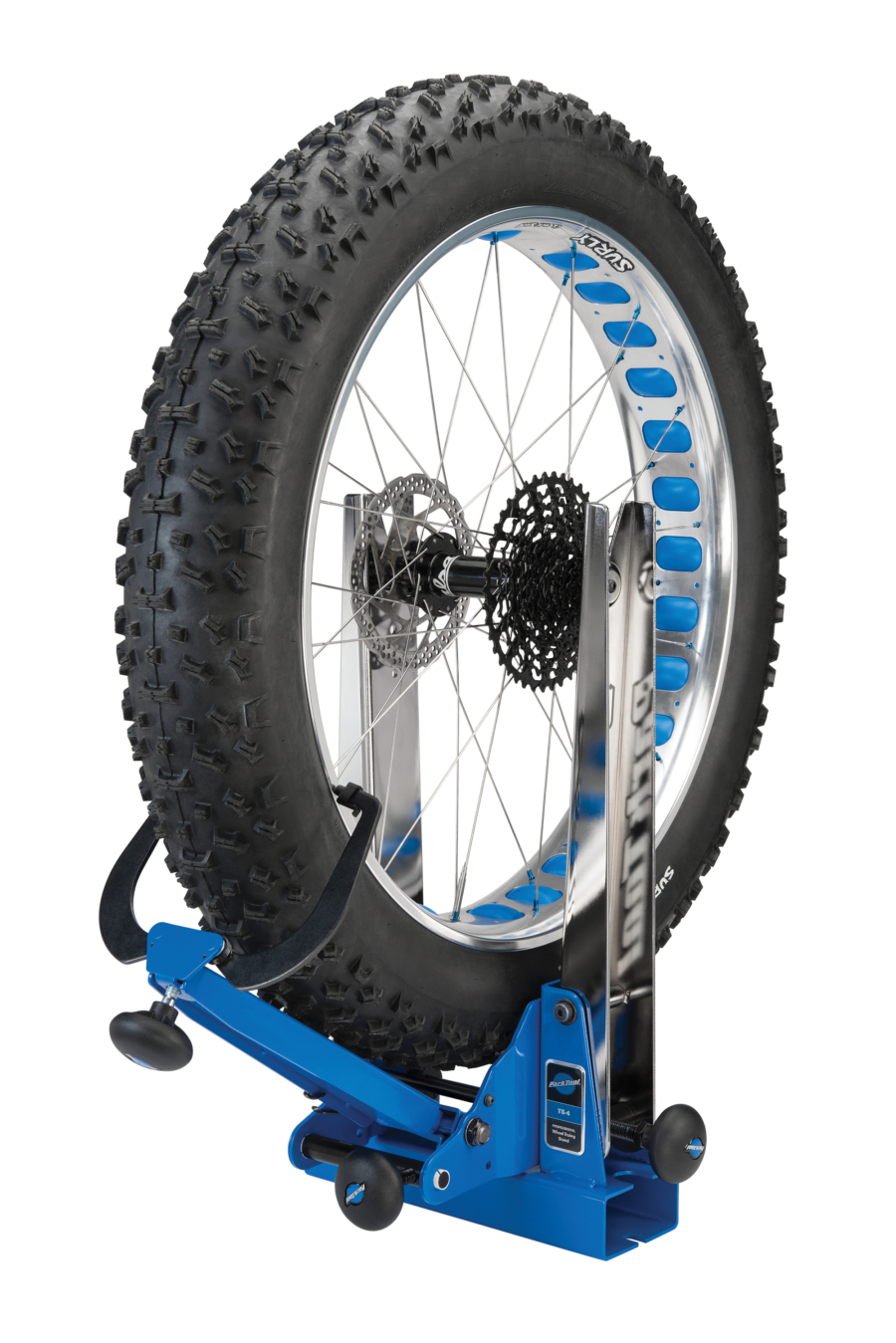 The Park Tool TS-4 Professional Wheel Truing Stand holding fat tire, enlarged