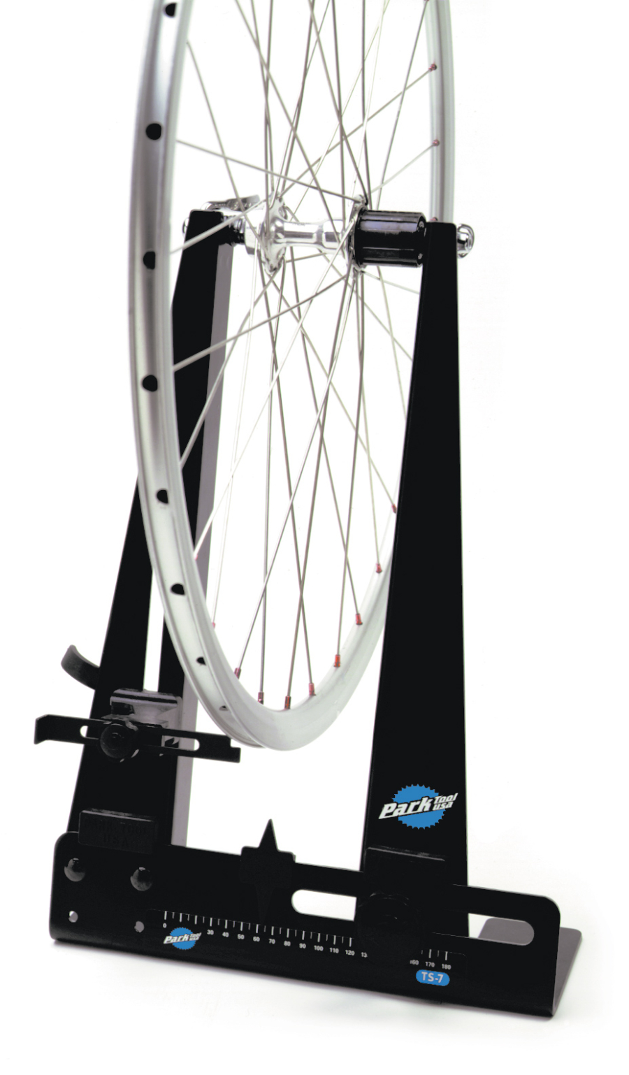 The Park Tool TS-7 Home Mechanic Wheel Truing Stand holding wheel, enlarged