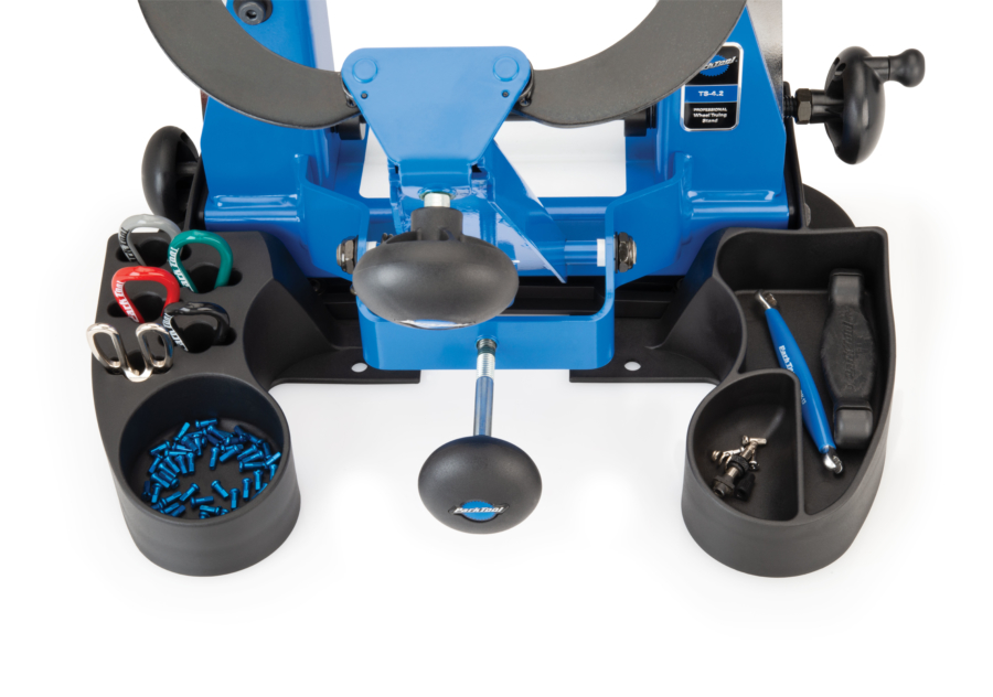 Park Tools in the compatible compartments of the TSB-4.2 Truing Stand Tilting Base, enlarged