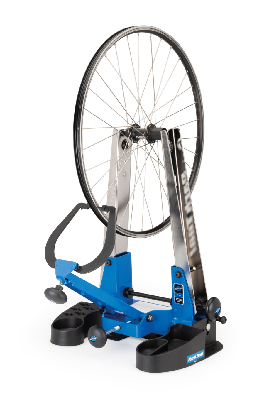 Bike wheel in a Park Tool Truing Stand Tilting Base, enlarged