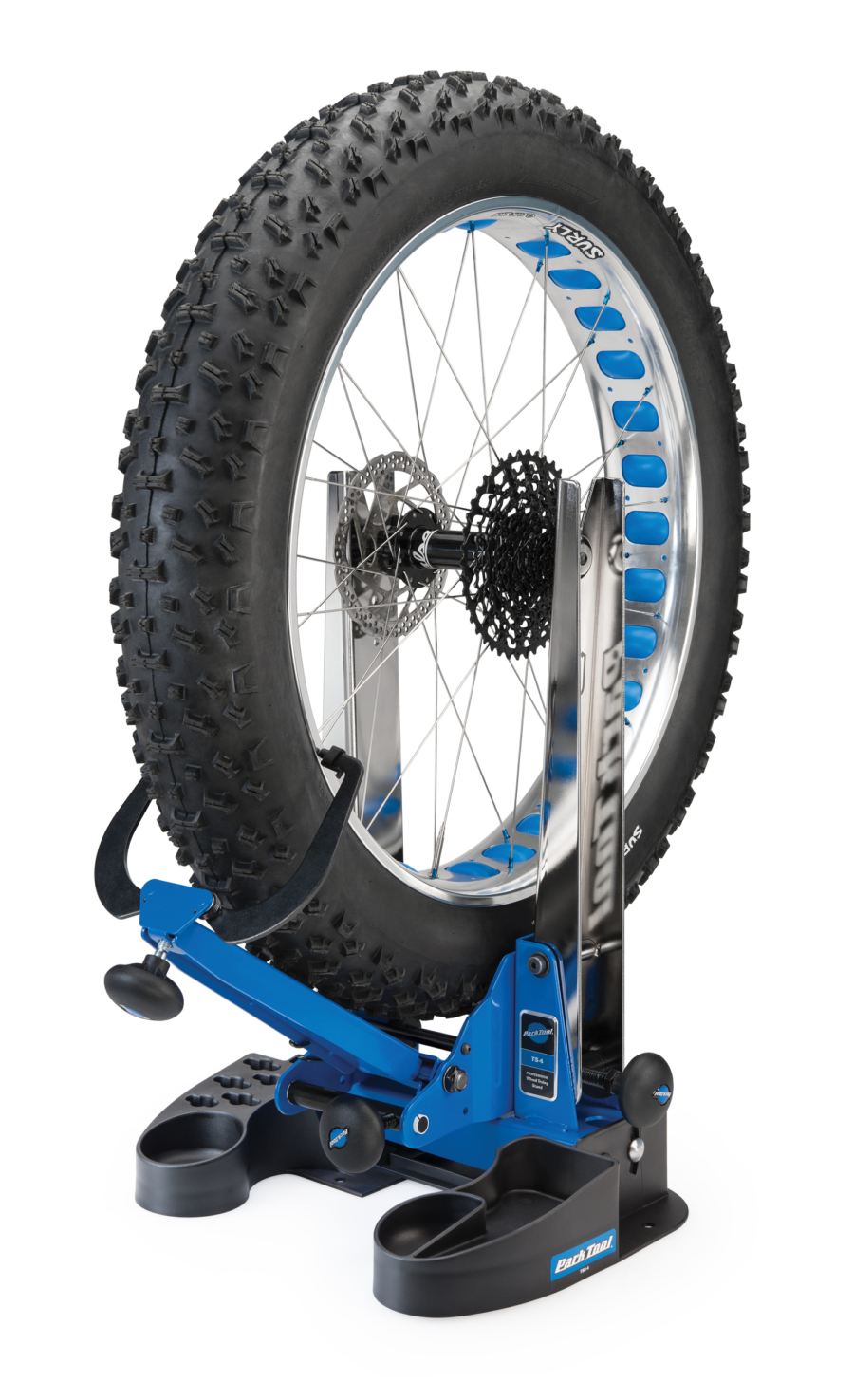 Park Tool TSB-4 Truing Stand Tilting Base with truing stand holding a fat tire bike wheel, enlarged