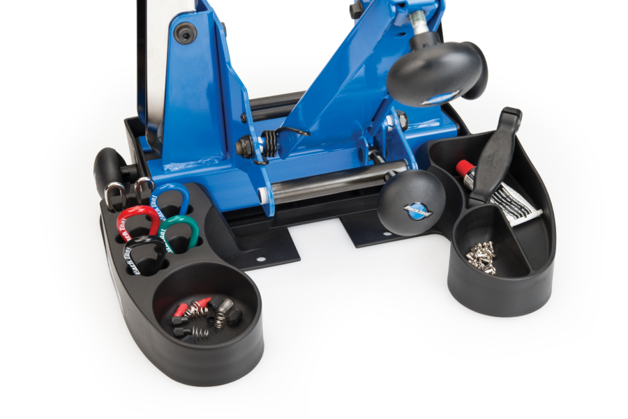 Park Tool TSB-4 Truing Stand Tilting Base compartments filled with bike tools and parts, enlarged
