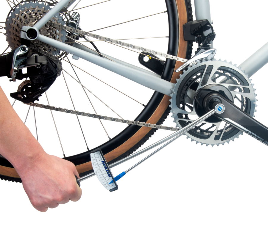 The Park Tool TW-2.2 Beam-Type Torque Wrench torquing a crank arm bolt on a gravel bike, enlarged