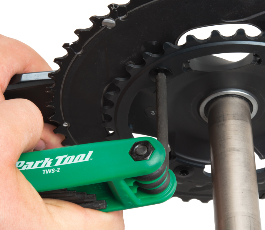 The Park Tool TWS-2 Fold-Up Torx® Compatible Wrench Set loosening a chainring bolt, enlarged