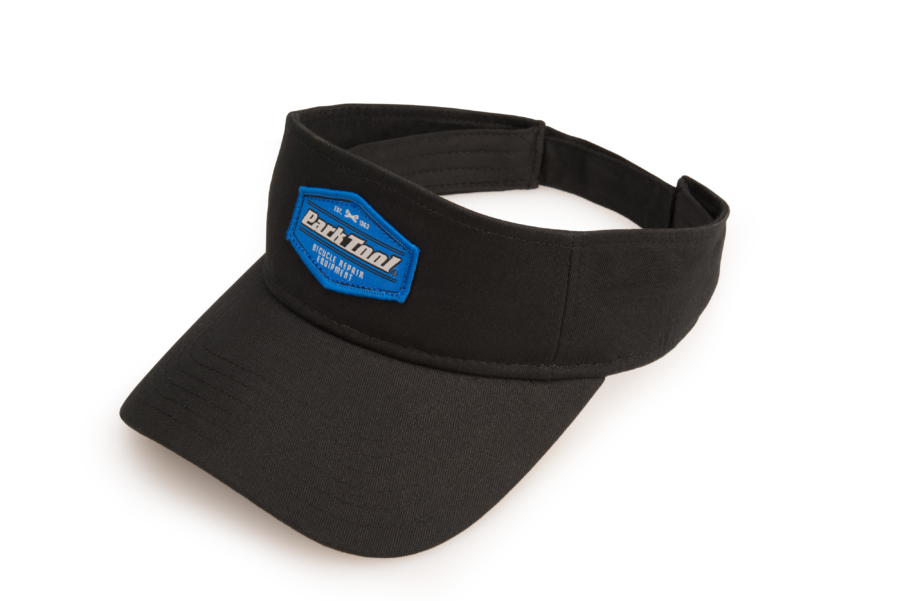 Front of black Park Tool visor with Park Tool emblem on front, enlarged
