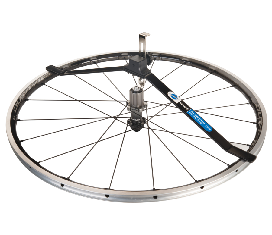 The Park Tool WAG-5 Wheel Alignment Gauge measuring dish on a rear road bike wheel, enlarged
