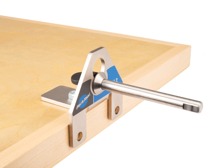 Park Tool WH-2, Wheel Holder clamped to the side of a workbench, enlarged