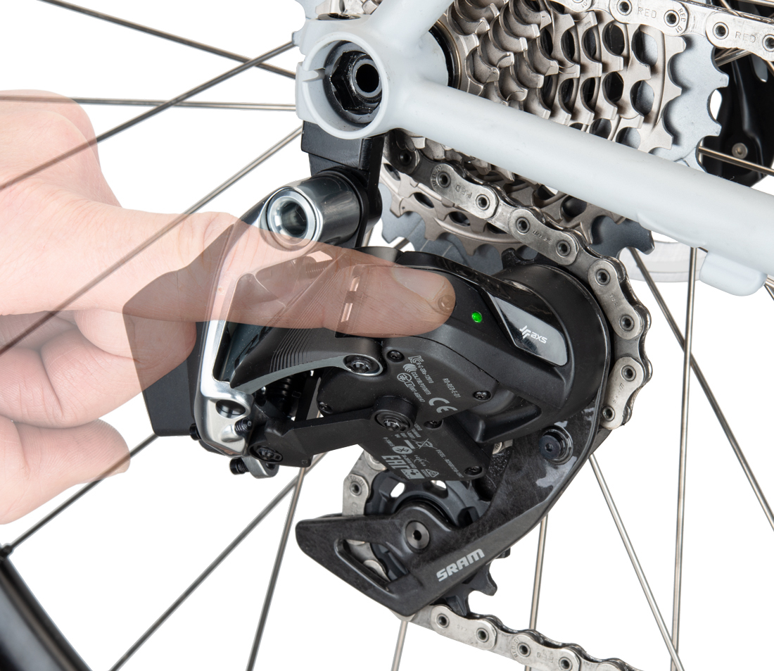 Press AXS® button at rear derailleur
