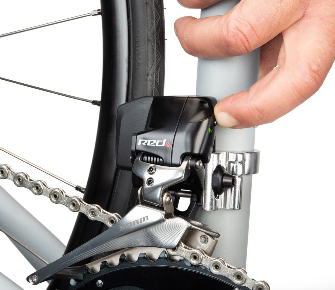 Press AXS® button on front derailleur