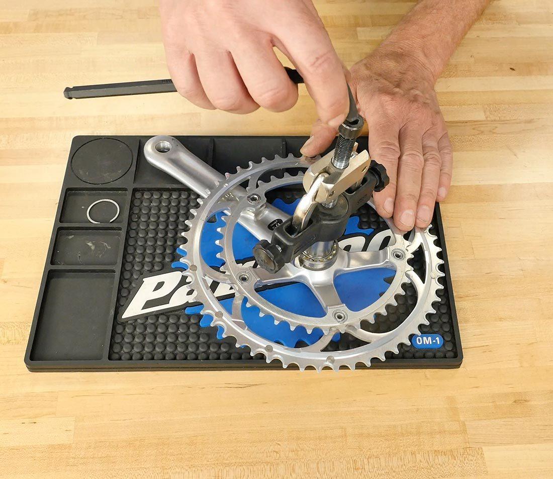 Engage bearing puller under edge of bearing