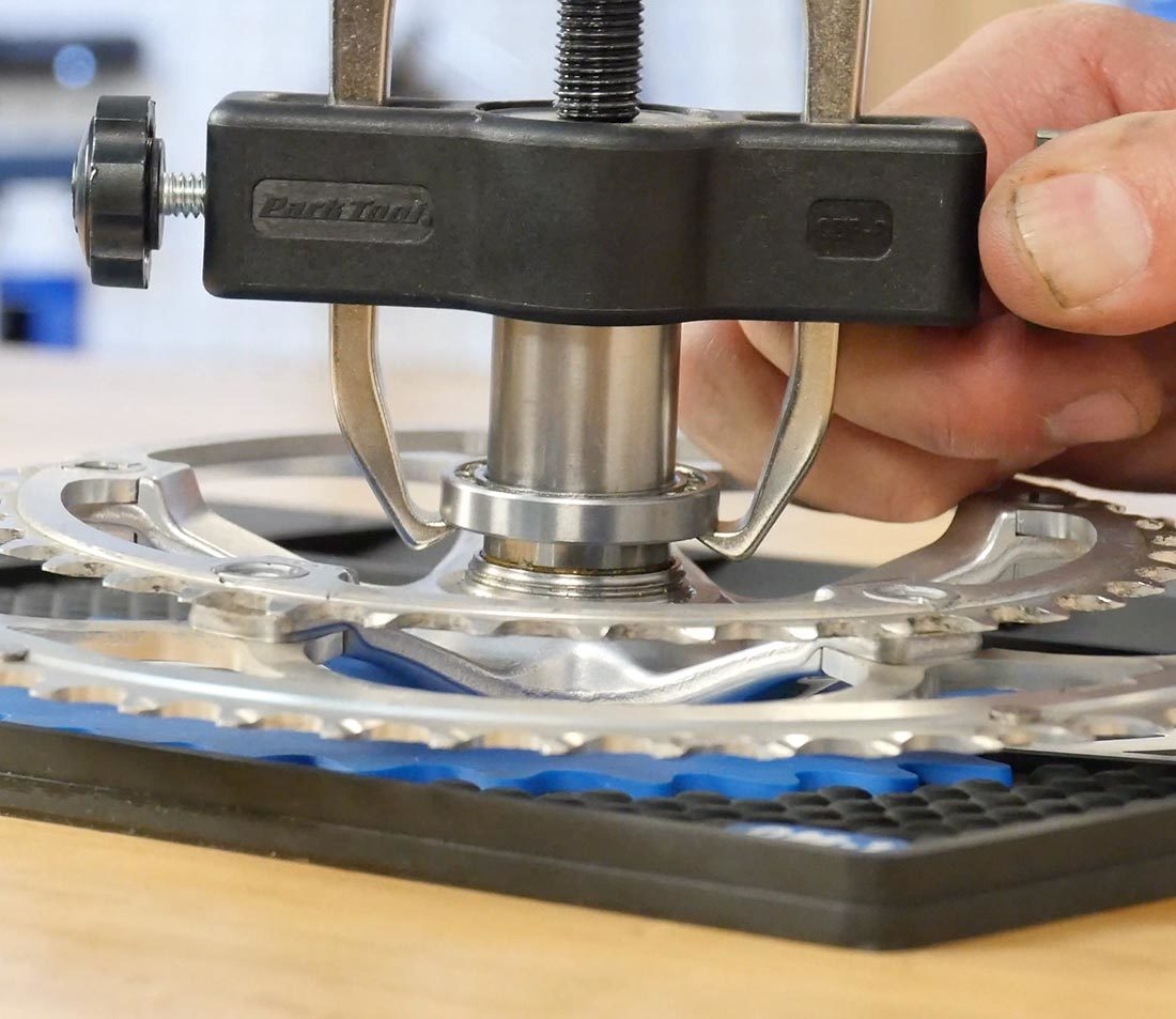 Turn driver to pull bearing off spindle