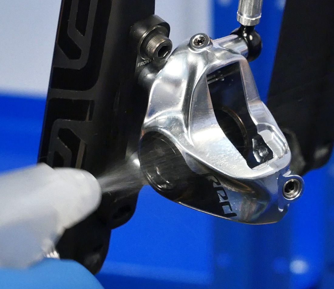 Brake caliper being sprayed with rubbing alcohol