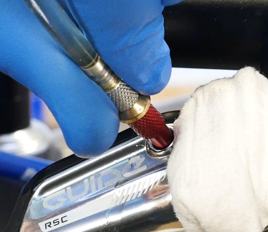 fully thread syringe into bleed port