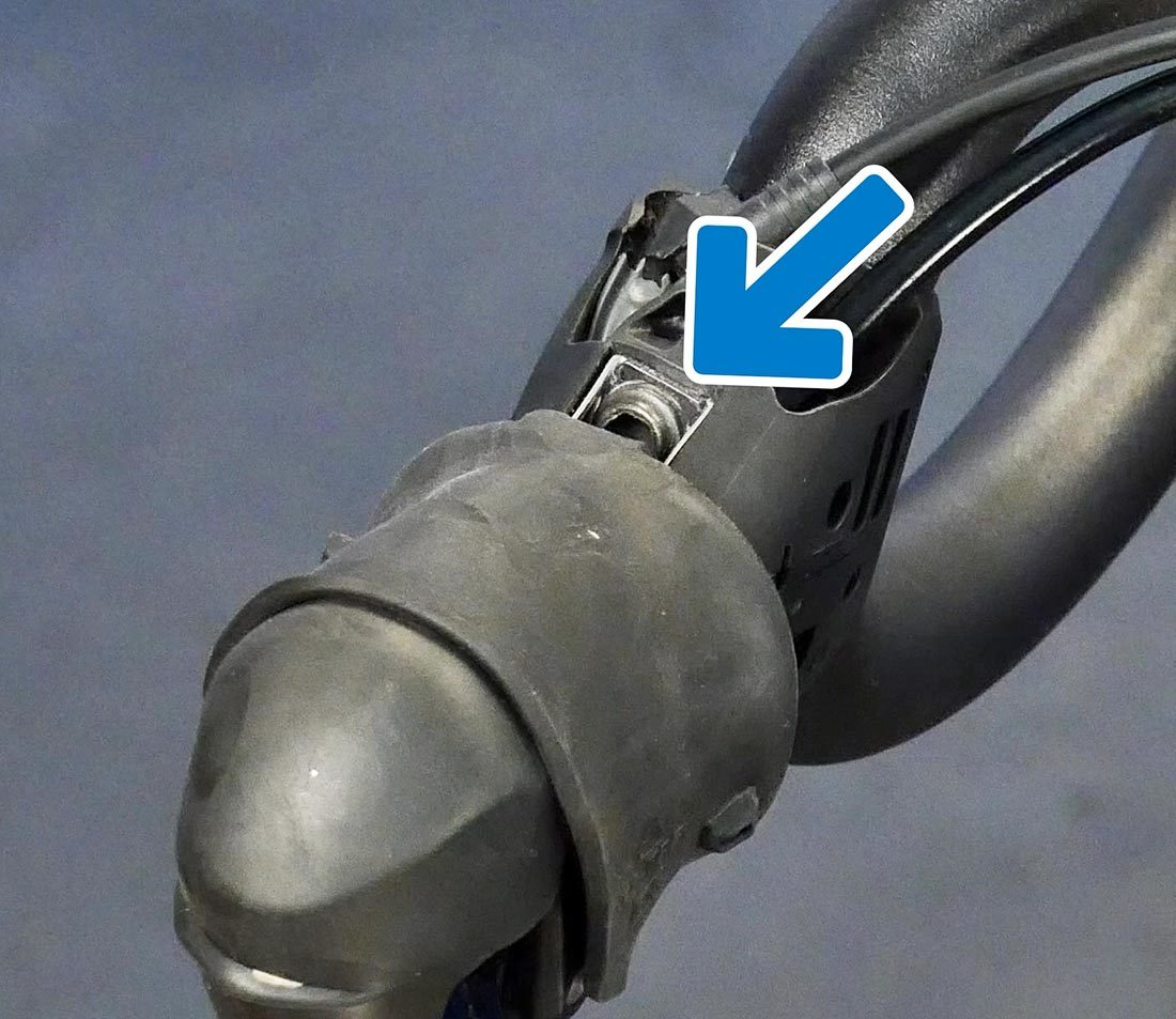 The lever mounting bolt is commonly found on top of the lever
