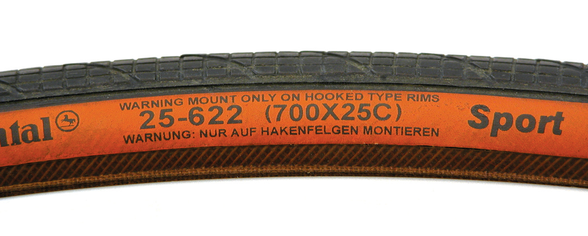 ISO (ETRTO) sizing numbers on tire label, along with French sizing