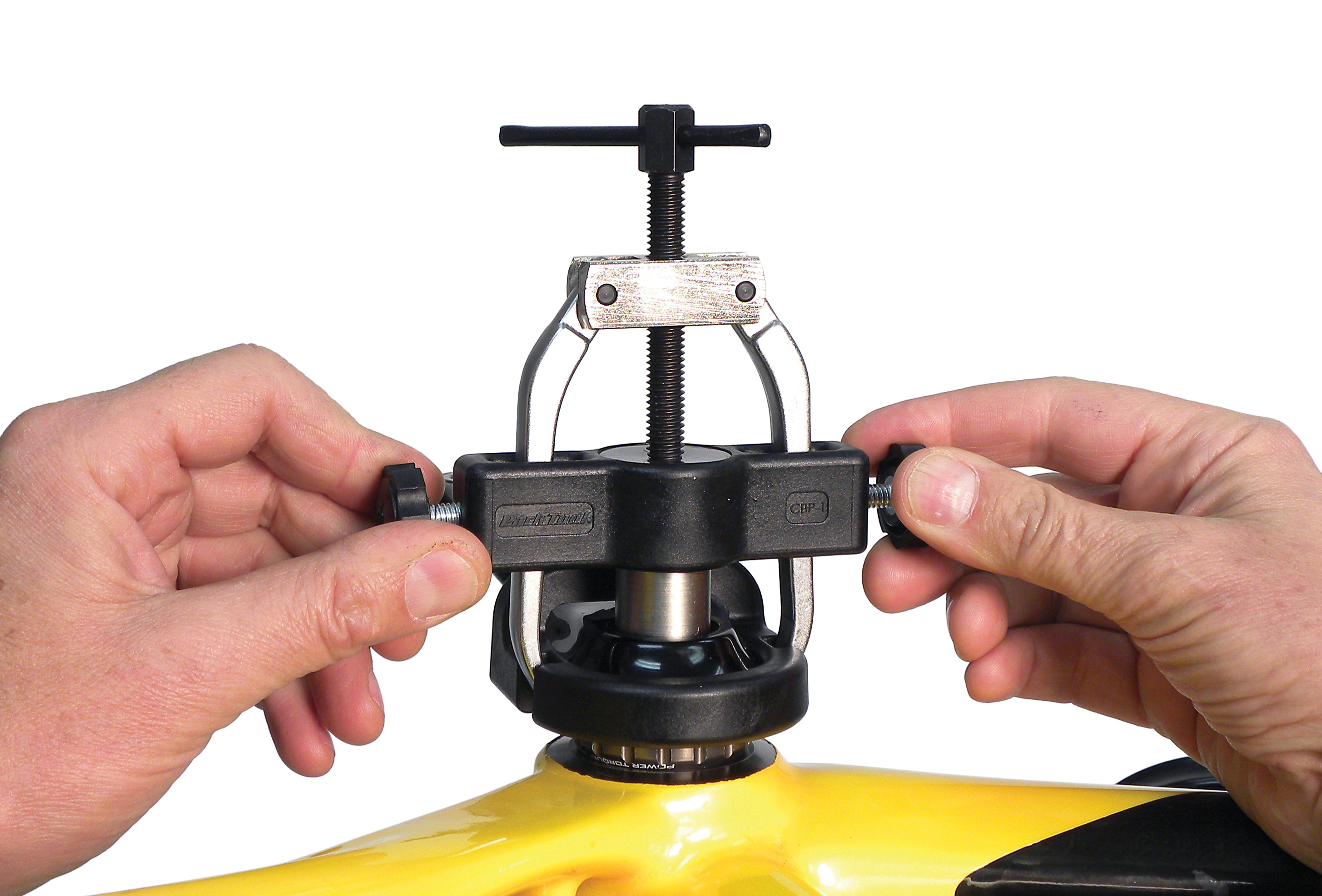 Adjust knobs on puller to remove excessive play at fingers