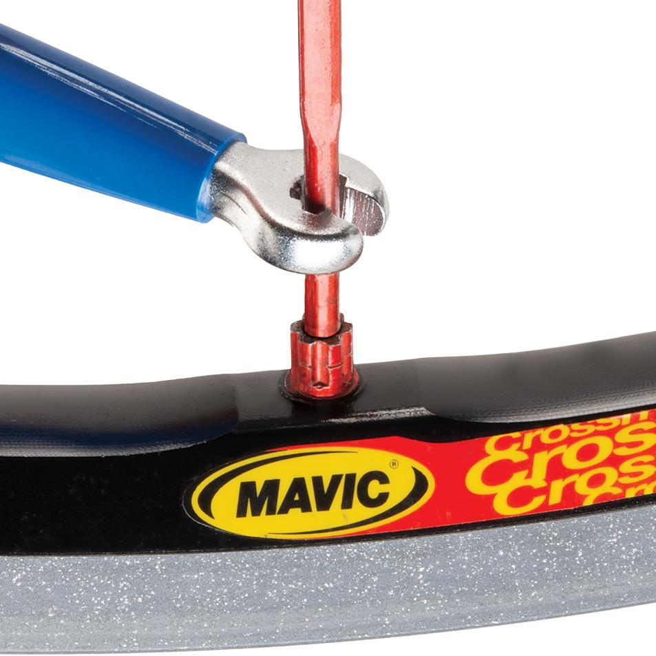 SW-13 double-ended spoke wrench being fitted to Mavic® six-splined spoke nipple on wheel