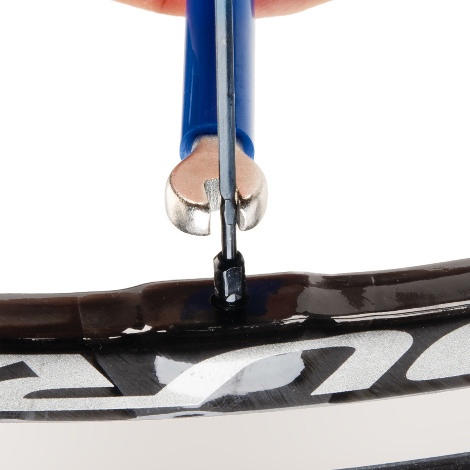 SW-14.5 double-ended spoke wrench being fitted to square Shimano® spoke nipple on wheel
