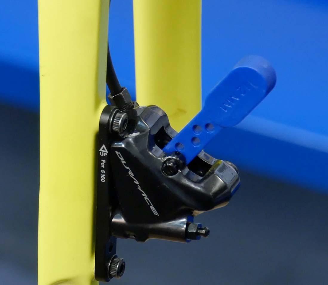Install bleed blocks between pistons