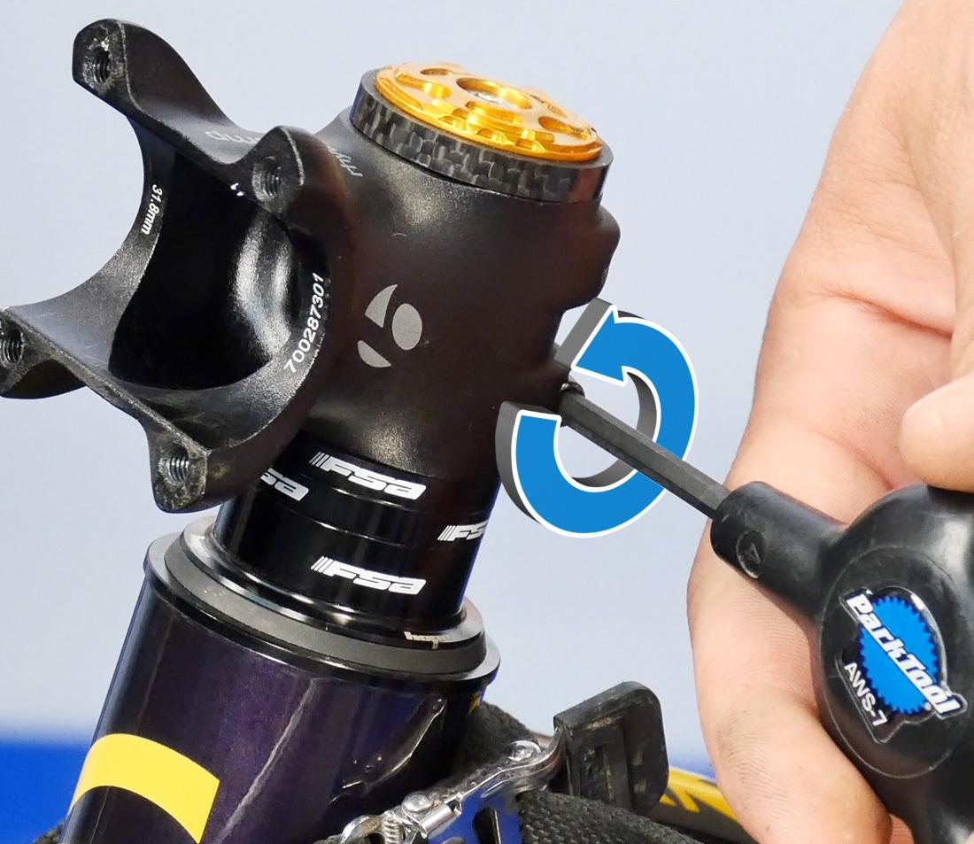 Loosen both pinch bolts