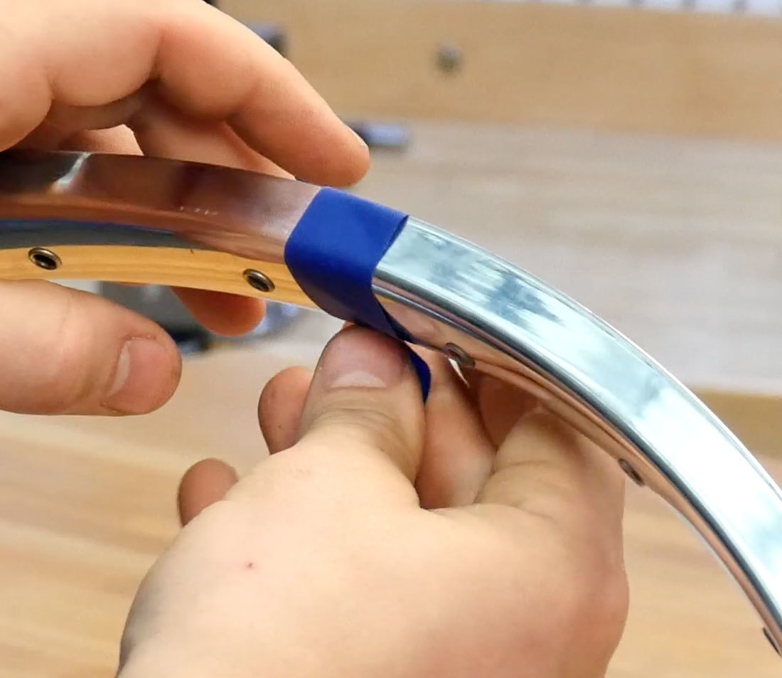 Blue masking tape being applied to chosen section of a rim as a reference mark