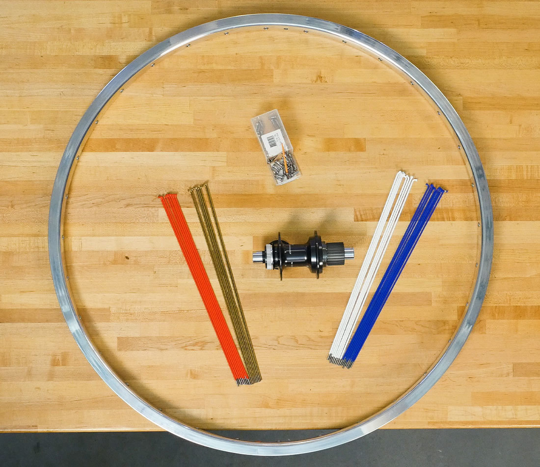 Workbench with all components laid out and organized for building a wheel