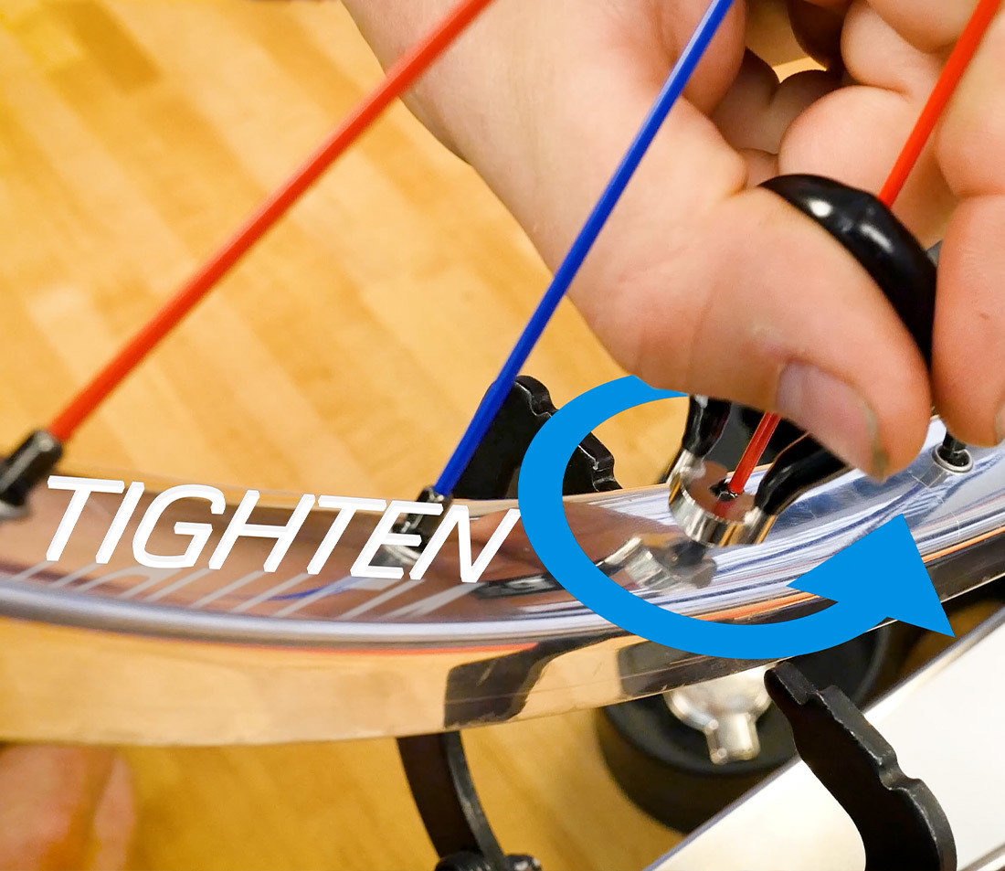 Perspective of tightening a spoke from above the rim