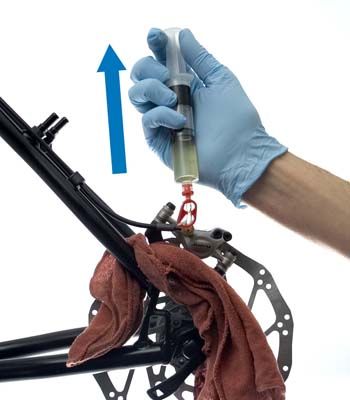 Figure 4. Pull back on plunger to draw any air from the caliper body