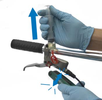 Figure 7. Pull back on plunger and tap body to free any air inside lever