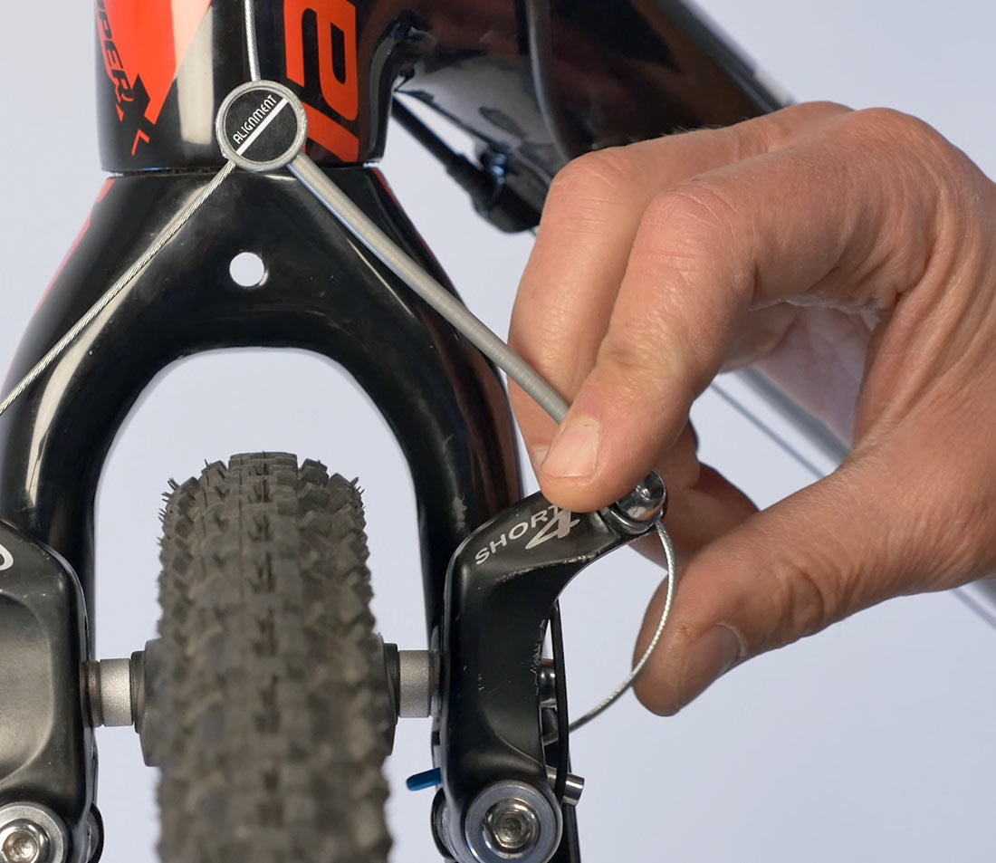 Tuck cable into brake
