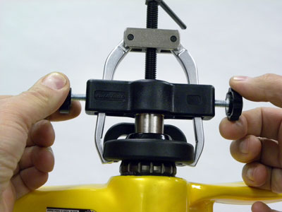 Install puller over extension stud and remove play from fingers