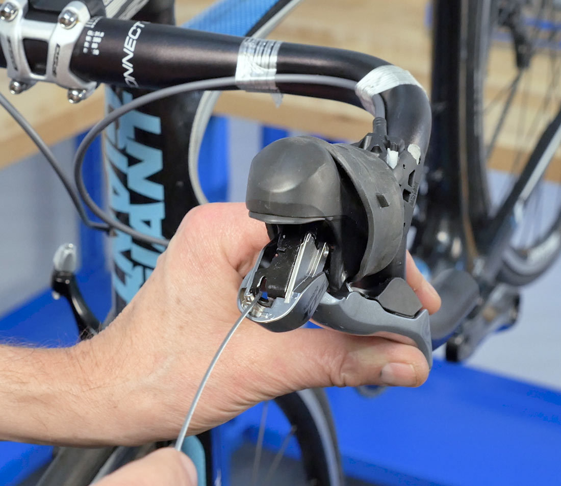 Engage cable end through brake lever