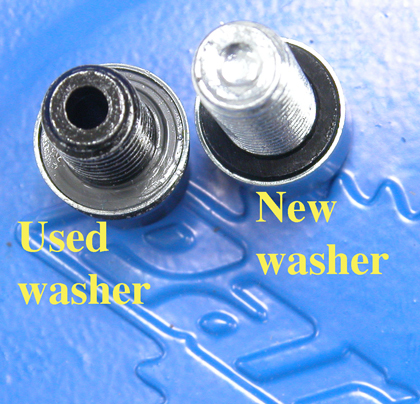 Figure 7. Replace crush washer if a leak develops at the bolt