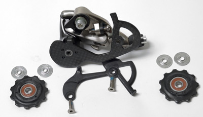 Pulleys and cage plate of SRAM® Force derailleur.